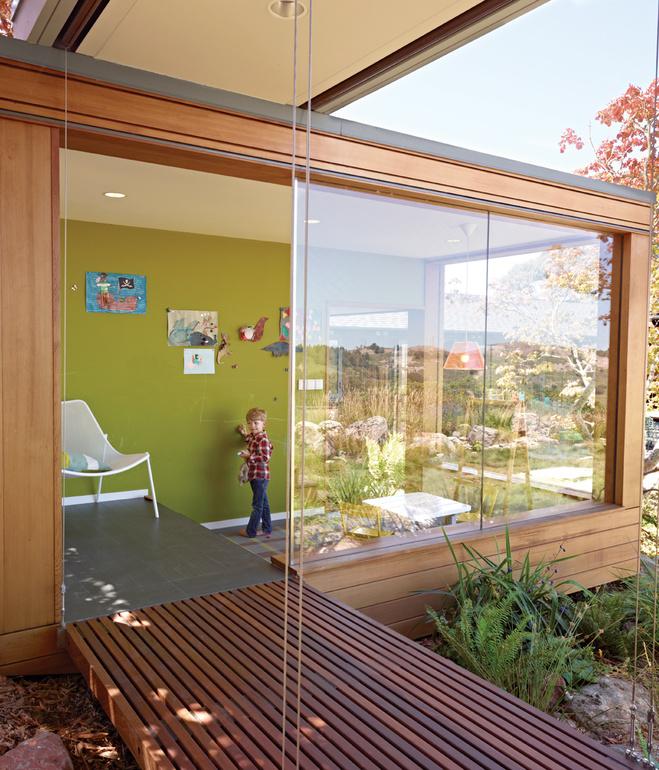 wooden modern house with water garden (7)