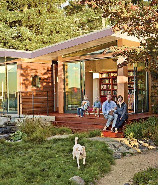 wooden modern house with water garden