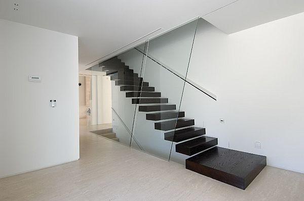 Black-floating-stiarcase-design-against-a-white-backdrop