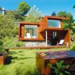 แบบบ้านไม้สไตล์โมเดิร์น สำหรับคนพื้นที่(และงบ)น้อย พร้อมสนามหญ้าหน้าบ้าน