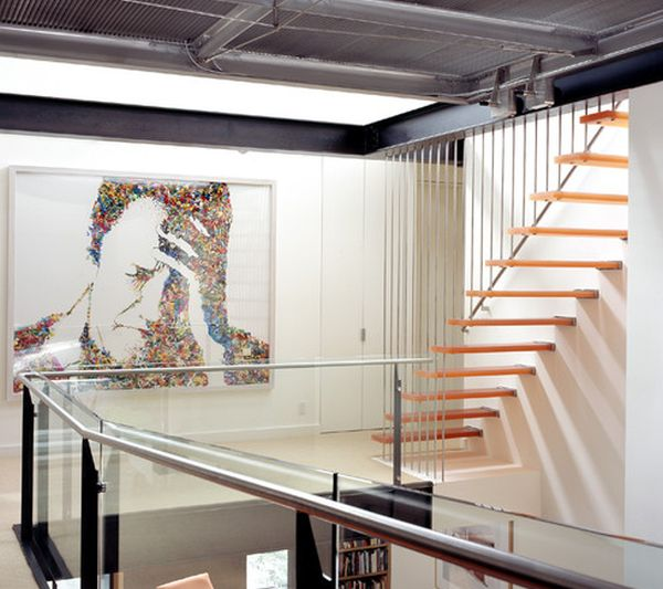 Interesting-art-work-and-lovely-floating-stairs-combine-to-give-this-home-a-chic-look