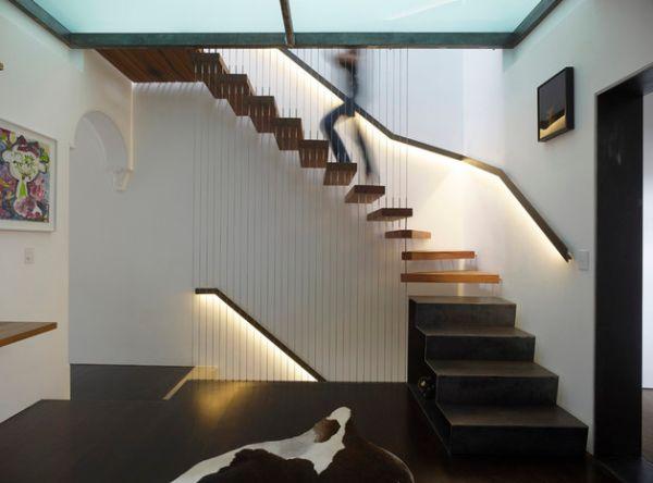 LED-lit-railing-illuminates-this-floating-stairway-gorgeously