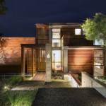 แบบบ้านปูนเปลือยสไตล์โมเดิร์นขนาด 2 ชั้น ผสมผสานไม้และกระจกอย่างเข้ากัน