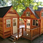 แบบบ้านไม้หลังคาหน้าจั่ว สร้างสองหลังเชื่อมต่อกันด้วยระเบียงตรงกลาง