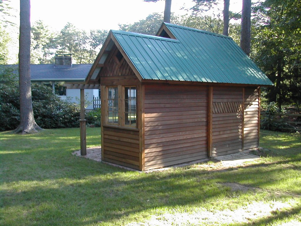 small wood cottage metal roof garden (1)
