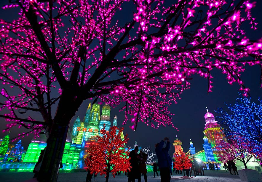 Visitors enjoy the sights at the Harbin International Ice and Snow Festival.