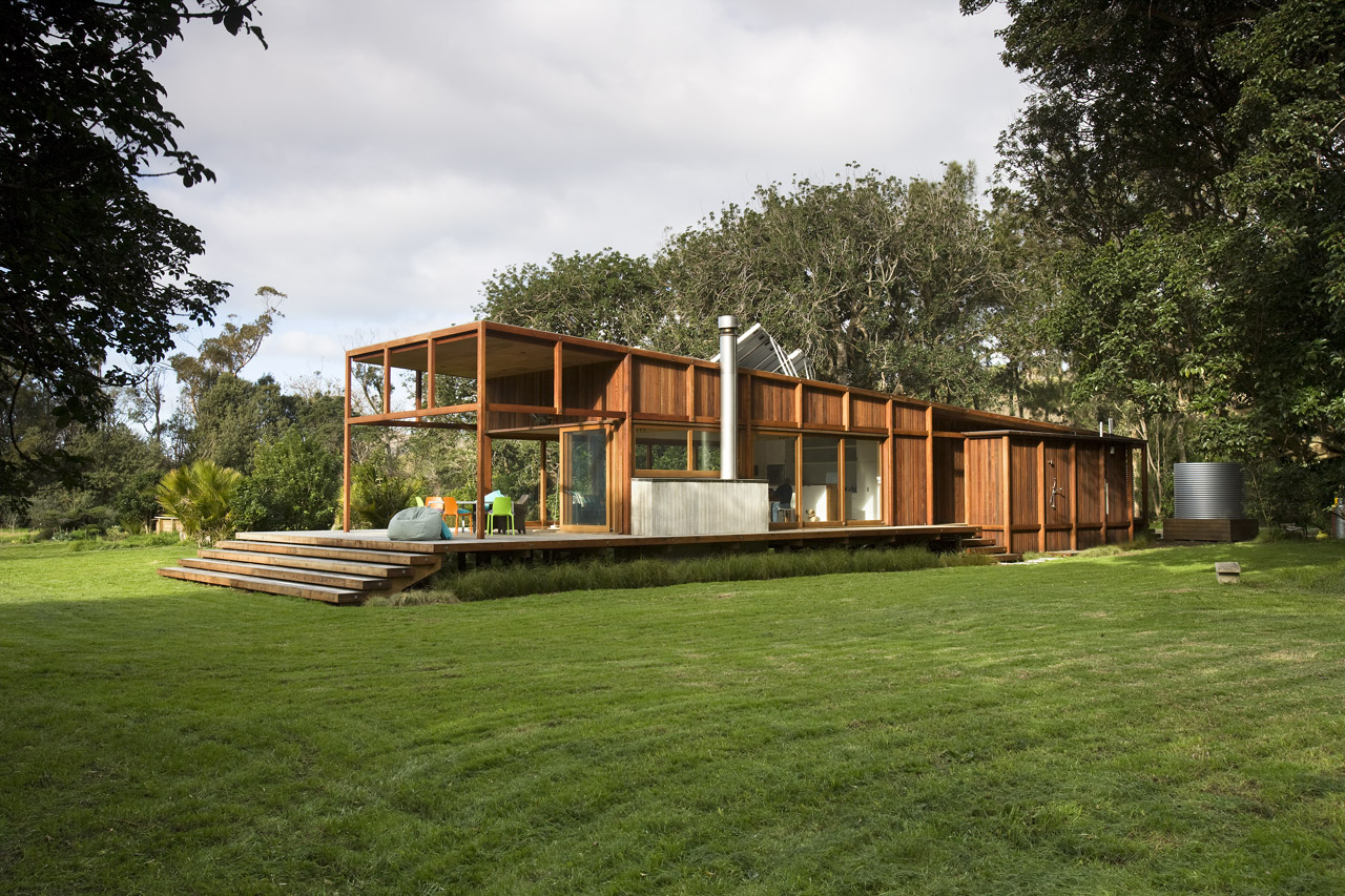 modern wooden glass house solar cell in forest new zealand (6)