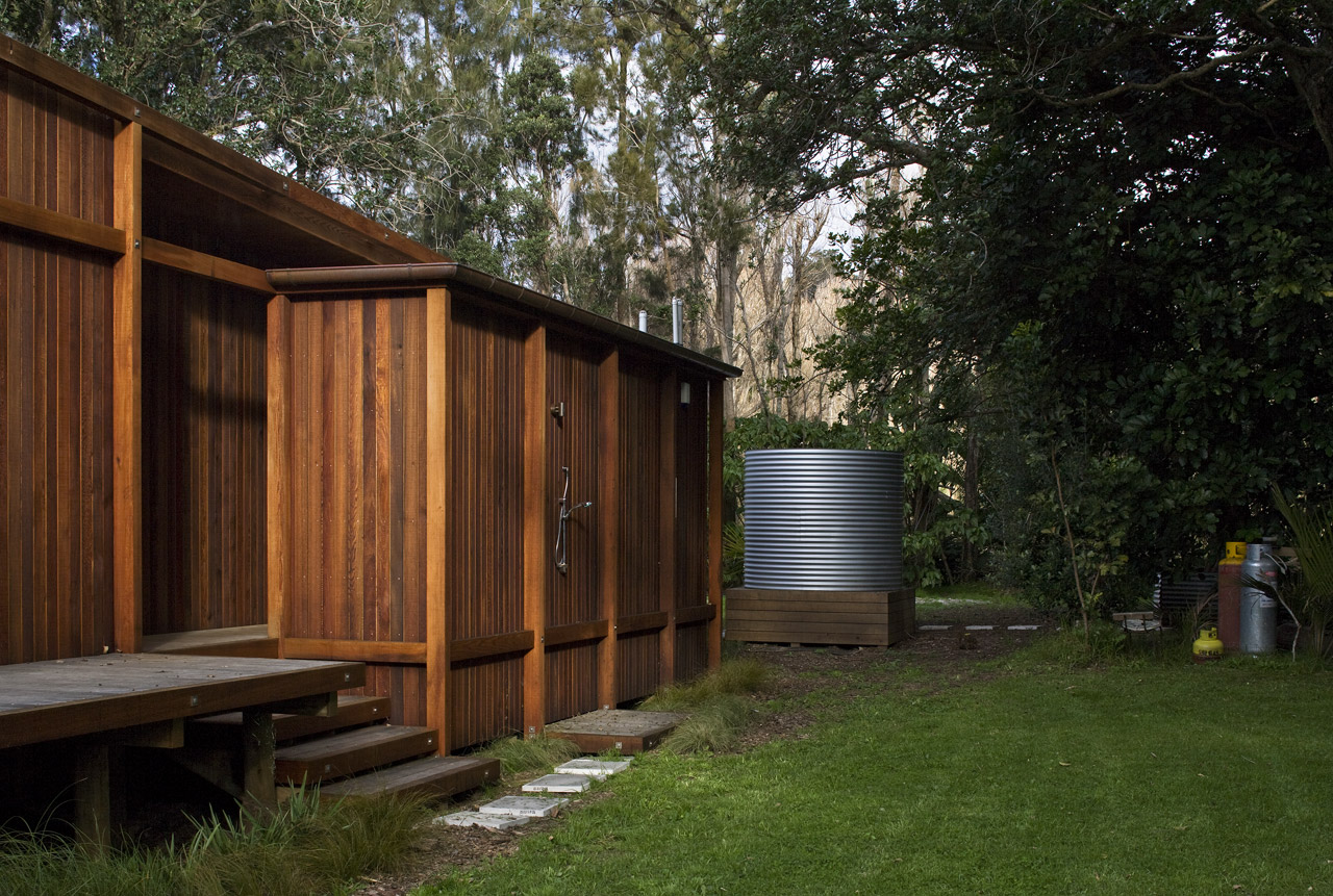 modern wooden glass house solar cell in forest new zealand (8)
