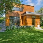 บ้านไม้สองชั้นแบบโมเดิร์น ออกแบบทรงหลังคาเรียบ กับภายในที่ดูโล่งโปร่งตา