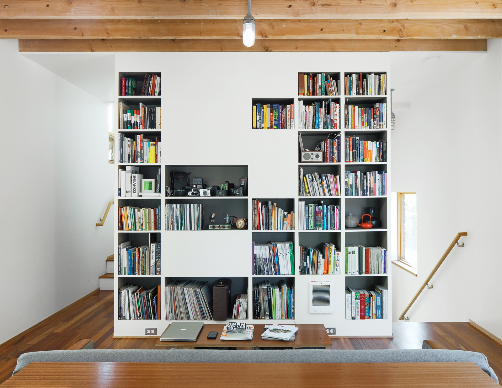 all-we-need-harpoon-house-bookshelf-living-room-interior
