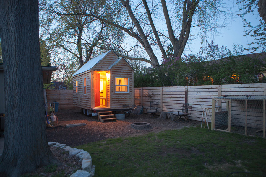 tiny wooden cottage house in yard (1)