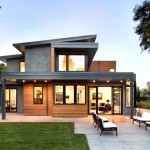 บ้านปูนเปลือยแบบโมเดิร์นร่วมสมัย ผสมกับไม้และกระจก ในรูปทรงสวยโดดเด่น