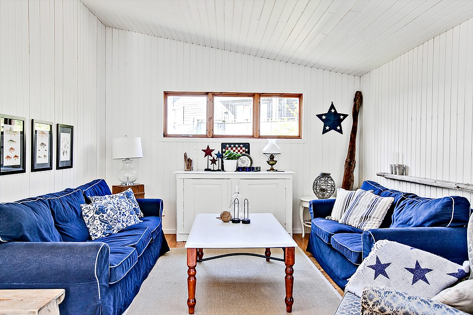country cottage house with white wooden design in swedish countryside (5)