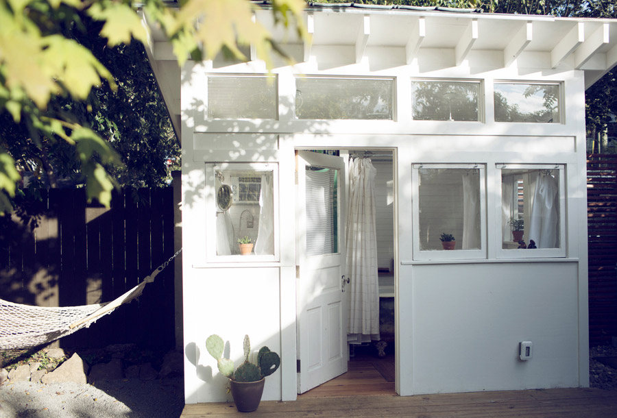 mini white retro shed in backyard for living serene and peachful (5)
