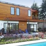 บ้านร่วมสมัยสองชั้นสไตล์อนุรักษ์ธรรมชาติ พร้อมสระว่ายน้ำสวย