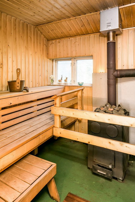 red-cottage-with-wooden-patio (3)