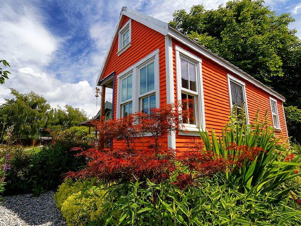 tiny-orange-wooden-cottage (1)