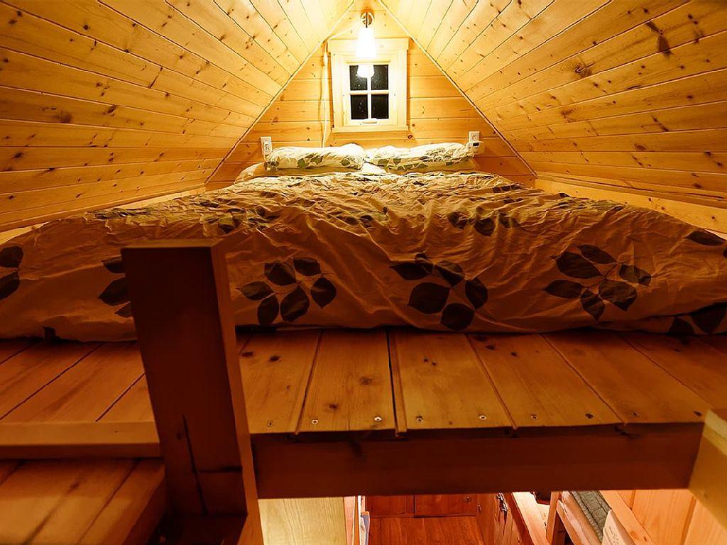 tiny-orange-wooden-cottage (4)