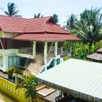 บ้านทรงไทยประยุกต์ ออกแบบพร้อมใต้ถุน และสระว่ายน้ำส่วนตัว