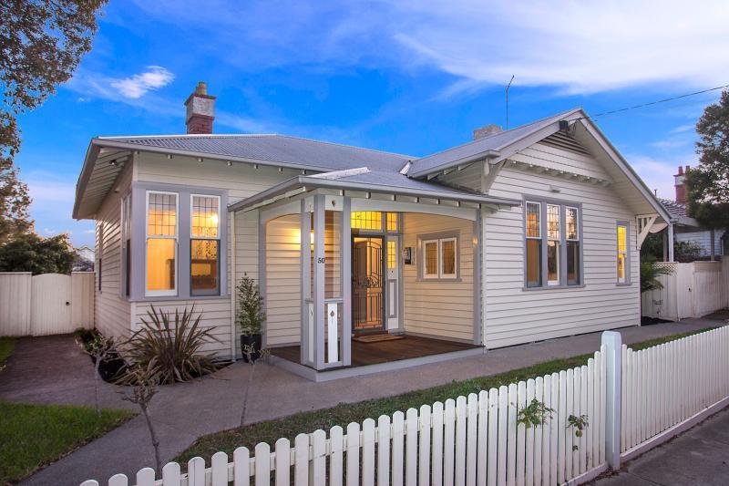 white weatherboard single house (1)