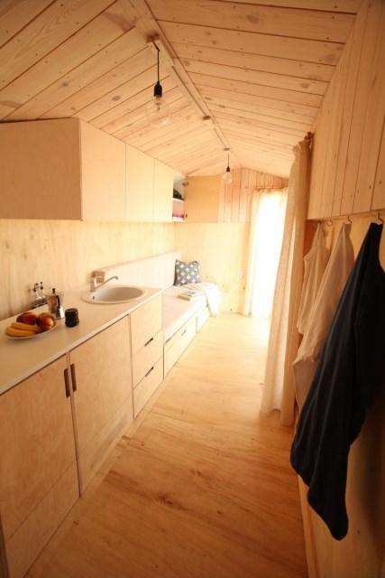 Hristina-Hristova-Tiny-House-Koleliba-Bulgaria-Kitchen-and-Sitting-Humble-Homes