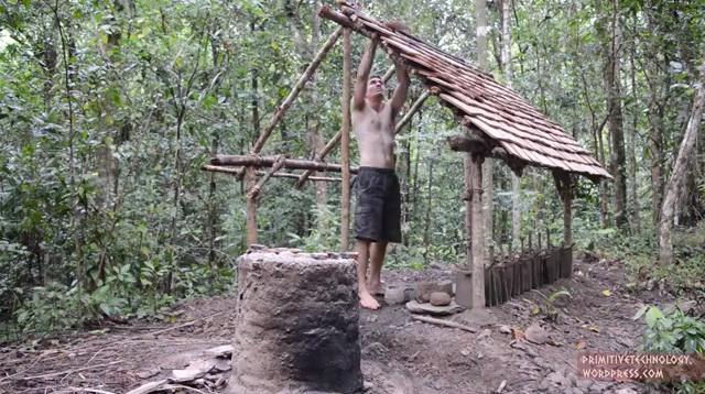 a crazy man building natural cottage (2)