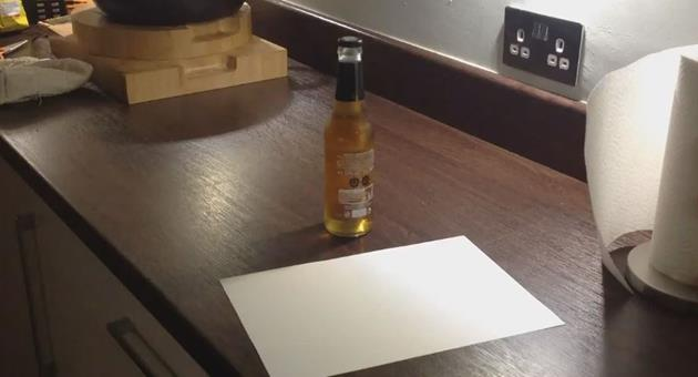 open-bottle-with-a-piece-of-paper (1)
