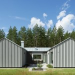 บ้านแฝดสร้างโดยวัสดุเมทัลชีท ออกแบบรูปทรงตัว U หลังคาหน้าจั่ว
