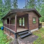 แบบบ้านไม้ทรงตัว L ออกแบบสไตล์บ้านสวน พร้อมชานขนาดพอเหมาะ
