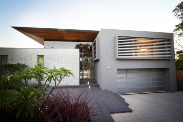 Fetching-modern-home-design-in-australia-featuring-exterior-wall-idea-with-marble-and-concrete-front-yard-plus-green-grass-lawn-also-garden-945x630