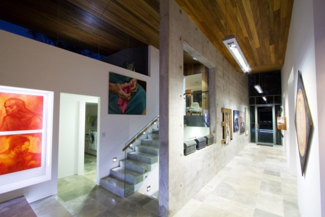 Interesting-contemporary-home-design-in-australian-featuring-interior-idea-with-marble-floor-staircase-glass-railings-wall-decor-and-wooden-ceiling-945x630