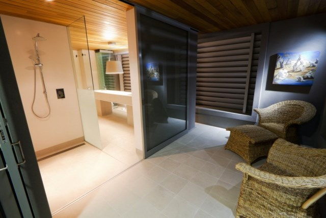 Mesmerizing-The-24-House-by-Dane-Design-Australia-featuring-interior-idea-in-bathroom-with-marble-floor-walk-in-shower-and-wooden-ceiling-945x630