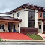 บ้านสไตล์โมเดิร์นทรอปิคอล หลังคาทรงปั้นหยา ในสีสันที่เข้ากับธรรมชาติ
