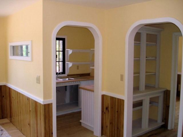 utilla-beach-cottage-living-to-kitchen-via-smallhousebliss