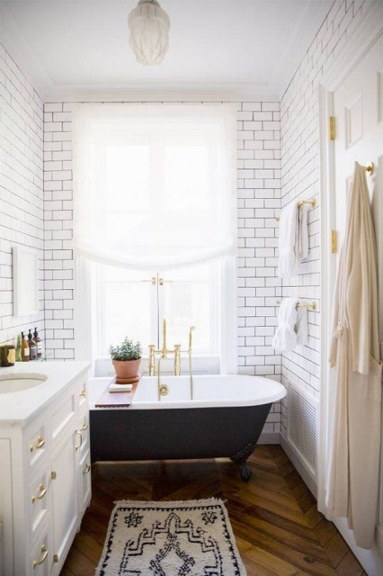 small-bathroom-with-black-tub-and-hardwood-flooring