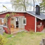 บ้านคอทเทจประยุกต์ ตกแต่งด้วยไม้และกระจก พักผ่อนแบบบ้านตากอากาศ