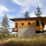 บ้านตากอากาศสไตล์โมเดิร์น ตกแต่งปูนเปลือยและไม้ สวยงามทามกลางธรรมชาติ