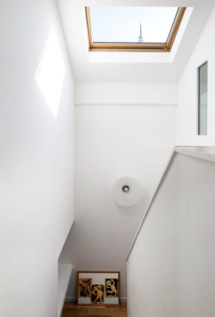 the-outer-limits-paris-prefab-home-velux-skylight-staircase-light-fixture