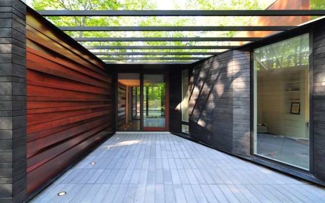 Sylvan-Retreat-textured-wood-structure-with-a-green-roof-10