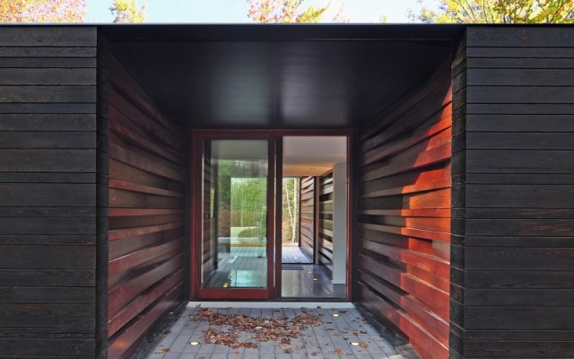 Sylvan-Retreat-textured-wood-structure-with-a-green-roof-11