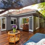 แบบบ้านไม้ระเบียงกว้าง ออกแบบโปร่งโล่งอยู่สบาย ดีไซน์เพื่อการพักผ่อนอย่างแท้จริง