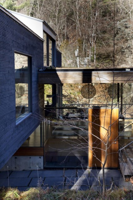 Modern two-story house mixed materials and natural materials (17)