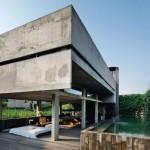 บ้านตากอากาศสไตล์โมเดิร์น ออกแบบรูปทรงหนักแน่น ตกแต่งด้วยปูนเปลือย ให้อารมณ์ดิบๆ อาร์ตๆ