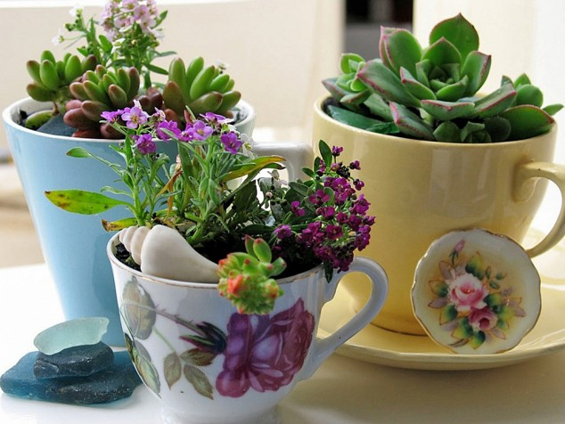 cleaver ideas Old Kitchenware Into Planters (11)