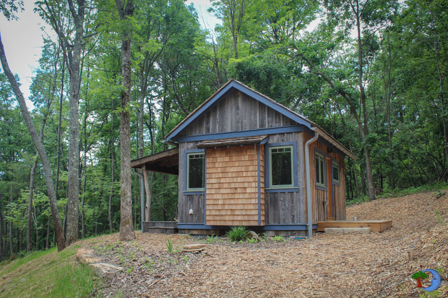 Compact cottage house forest side (1)