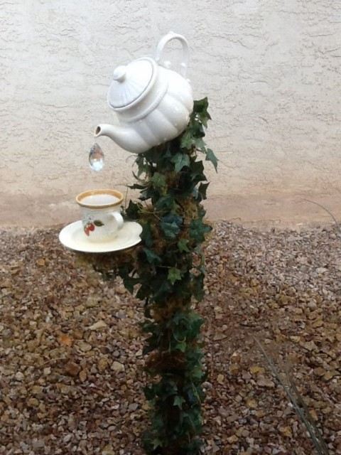 22-diy-ideas-old-teapot-to-flowerpot-14