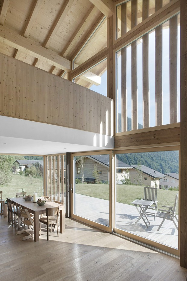 minimal-wood-house-among-valley-by-alp-4