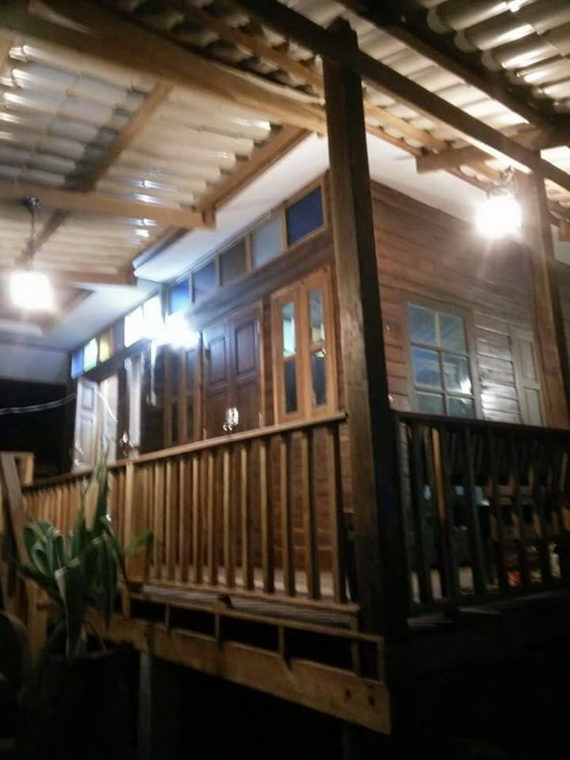 small-wood-raised-up-house-in-countryside-review-58