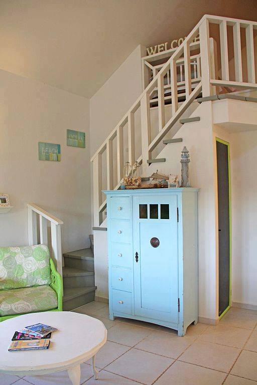 small-white-green-cottage-house-5