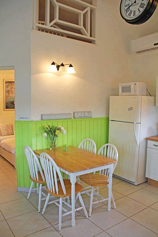 small-white-green-cottage-house-8